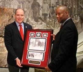 Prince Albert II received a commemorative gift from CO/WY District Manager Selwyn Epperson.