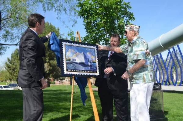 Arizona Secretary of State Ken Bennett; USPS, Arizona District, Manager of Operations Programs Support John Morgan; and U.S. Army Veteran, Pearl Harbor Survivor and Mesa, AZ, resident Albert Thomas reveal the USS Arizona Memorial stamp.