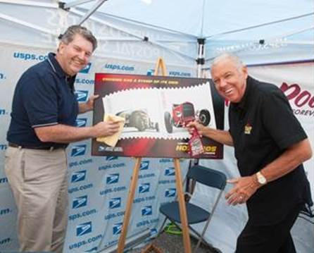 "Postmaster General Patrick Donahoe and ""Car Crazy TV"" Host and car care products mogul Barry Meguiar take a shine to the new limited-edition Hot Rods Forever Stamps issued this month."