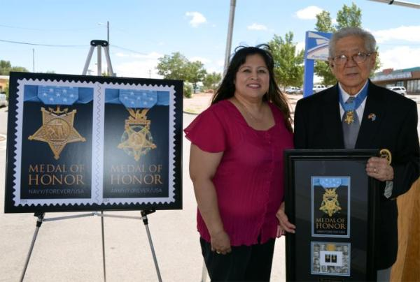 Gallup, NM, Postmaster Thelma Malone with Medal of Honor recipient Hiroshi Miyamura.