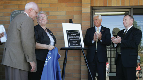 Margaret Anderson's parents Paul and Dorothy Kritsch on the left with Congressman Dave Reichert, second from the right, and Acting Seattle District Manager Don Jacobus, right, with the plaque dedicating the Eatonville, WA, Post Office in honor of Anderson.