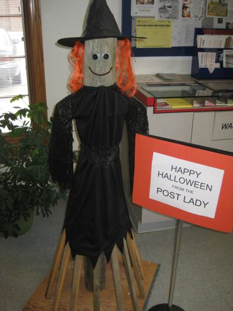 This individual with bright, orange hair was photographed by Postmaster Cindy Recker at the Peosta, IA, Post Office.