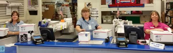 Retail Associates Judy Myers, Betty Macauley, and Postmaster  Lynne Tonn helped Pat Greer send smiles to the troops.