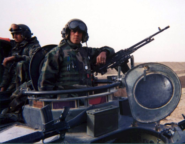 U.S. Marine Sergeant Kamm Davis aboard a light armored vehicle while serving in Operation Iraqi Freedom.