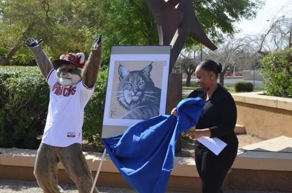 Arizona Diamondbacks mascot D. Baxter helped Mesa Postmaster Yolanda Stenson unveil the 1-cent Bobcat U.S. Postage Stamp.