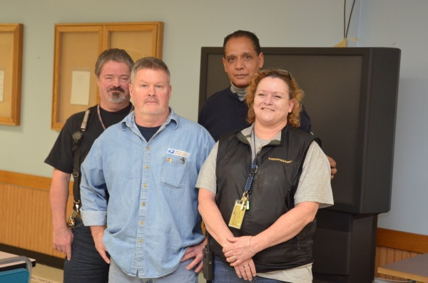 Seattle NDC employees who received the PMG's hero award from the left are Samuel Nations, Mark Harris, Roy Tatum and Margaret Grant.
