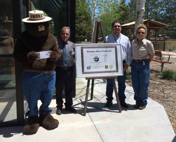 Smokey Bear, Capitan Postmaster Ralph Griffo, acting Post Office Operations Manager Paul Pantoja, and Smokey Bear Historical Park Manager Bennie Long.