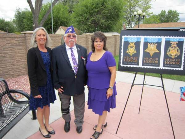 Colorado Springs, CO, Customer Relations Coordinator Linda Neill, Military Order of the Purple Heart Chapter 423 Senior Vice Commander Larry Hathaway, and Fountain, CO, Postmaster Yvette Trujillo.