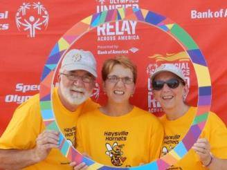 Wichita, KS, Mail Handler Lenard Hostetler, Special Olympian Casey Hostetler, and Casey's mother Gloria Hostetler.