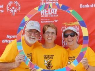 Wichita, KS, Mail Handler Lenard Hostetler, Special Olympian Casey Hostetler, and Casey's mother Gloria Hostetler.
