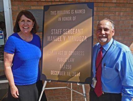 U.S. Representative Ann Kirkpatrick with Postmaster Mike Quintana.