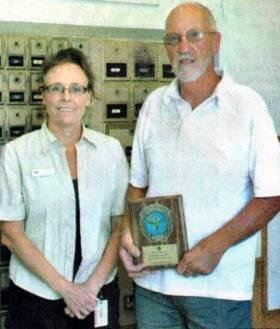 Mondovi, WI, Postmaster Kim Haas with Rural Carrier Wayne Diller.
