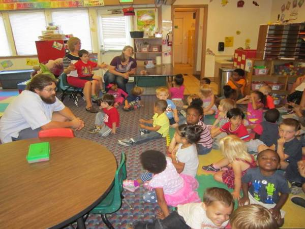 City Carrier Assistant Jeremy Shute chats with preschoolers.