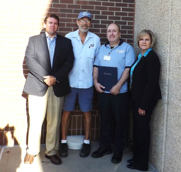 Kansas City Postmaster Jeff Drake, City Carrier Fred Green, Retail Associate Tom Murillo, and Mid-America District Manager Gail Hendrix.