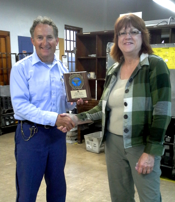 David City, NE, City Carrier Larry Bruns with Postmaster Sherri Helman