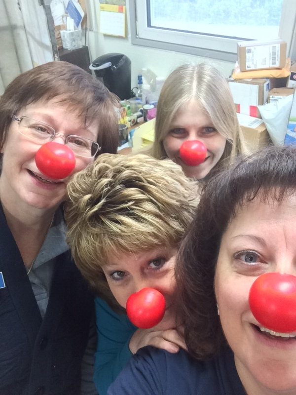 Healy, AK, employees with their red noses – Retail Associate Kathy Hennigan, Postmaster Aleta Blanchard and Retail Associate Terri Lundgren. In the back is Sonya Hulse, cleaning contractor.