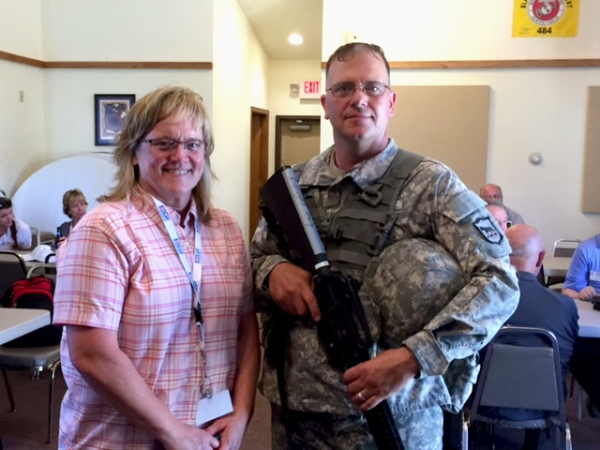 Hot Springs, SD, Postmaster Marcia Kenobbie with City Carrier Jeffrey Beougher.