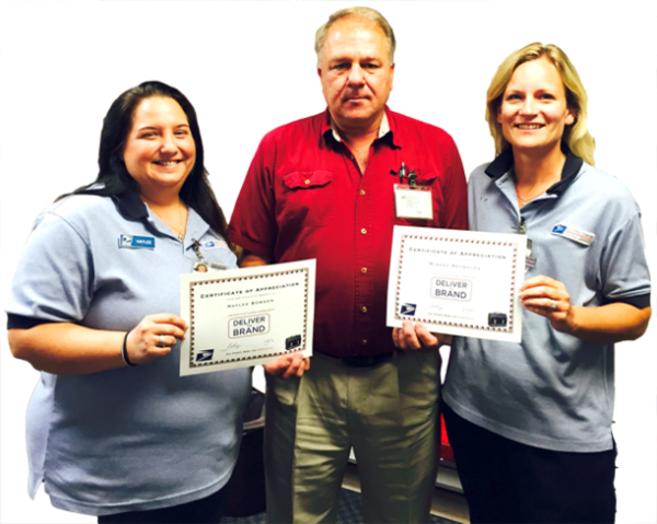 Chapman, KS, Retail Associates Haylee Bowden and Mindee Reynolds with Postmaster Darrell Dome.