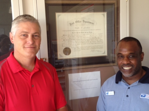 Junction City, KS, Postmaster Charles Lincoln (Postmaster over White City) and White City, KS, RMPO Retail Associate Lawrence Reece.
