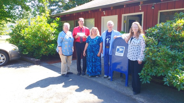 Cougar, WA, former Officer in Charge and current Retail Associate Tina Moir, Current Postmaster Chris Lusk, Postmaster (2001-2011) JoAnn Baker, Postmaster (1989-2001) Warren Moir, and Postmaster (1982-1985) Shelley Graybill.