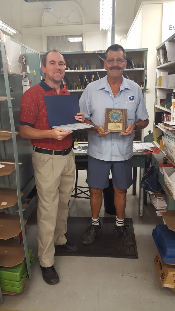 Coffeyville, KS, Postmaster Curtis Knipe with City Carrier Leroy Bakken