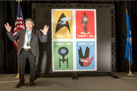 "Walter Koenig, who portrayed Pavel Chekov on ""Star Trek,"" poses in front of a stamp display at a ceremony in New York."