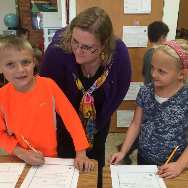 Stanford, MT, Retail Associate Sarah Bracha teaches the craft of letter writing to local students.