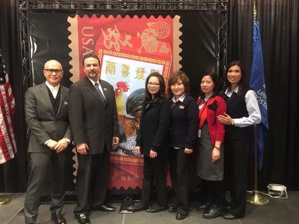 Stamp artist Kam Mak, Western Area VP Greg Graves, and Retail Associates Jianmei Guan, Jennifer Kim,Xiao Chen and Haoi Tran.